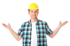 Happy worker presenting copy space. Royalty Free Stock Images