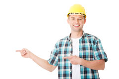 Happy worker presenting copy space. Royalty Free Stock Image