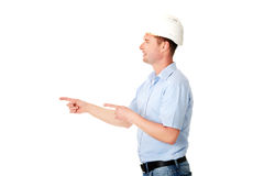 Happy worker presenting copy space. Stock Photo