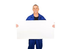 Happy worker presenting empty banner.  Stock Photography