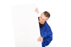 Happy worker presenting empty banner.  Royalty Free Stock Photos