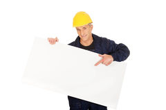 Happy worker presenting empty banner.  Royalty Free Stock Images