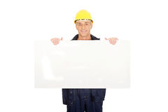 Happy worker presenting empty banner. Happy mature worker presenting empty banner Royalty Free Stock Photo