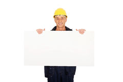 Happy worker presenting empty banner. Happy mature worker presenting empty banner Stock Photos