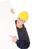 Happy worker presenting empty banner. Happy mature worker presenting empty banner Stock Images