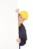 Happy worker presenting empty banner. Happy mature worker presenting empty banner Royalty Free Stock Images