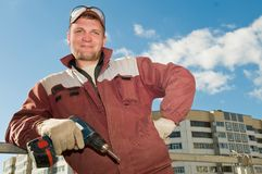 Happy worker with screwdriver Royalty Free Stock Photography