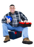 Happy worker seating. On the tool box, white backround Stock Image