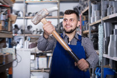 Happy worker showing his working tools Stock Photography