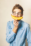 Happy worker smiling with banana Royalty Free Stock Photo