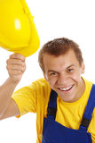 Happy worker take off his hard hat Stock Photography