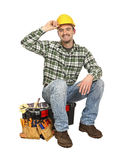 Happy worker on toolbox Stock Photo