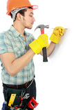 Happy worker using hammer Stock Photos