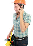 Happy worker using mobile phone Stock Photo