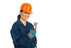 Happy worker woman holding pincers Stock Image