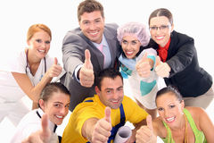 Happy workers. Gesturing thumb up sign Stock Image