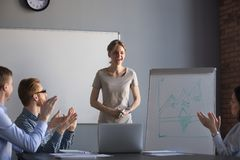 Happy workers applauding thanking businesswoman for presentation Royalty Free Stock Photography