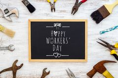 Happy Workers' Day background concept. Rusty old hand tools with blackboard and text writing Happy Workers' day. Celebrate chalkboard construction royalty free stock photo