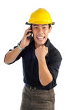 Happy workers with excited expression. Happy workers wearing safety helmet with excited expression. His hand hold a mobile phone Royalty Free Stock Photos