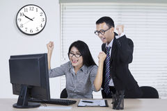 Happy workers expressing their winning Royalty Free Stock Photos