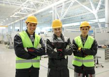 Happy workers in factory royalty free stock photos