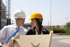 Happy workers planing house Royalty Free Stock Photography