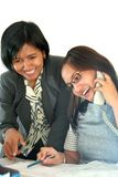 Happy working. Photograph of two girl in happy working royalty free stock image