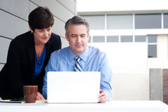 Happy working business team in modern office Stock Photography