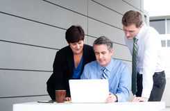 Happy working business team in modern office Royalty Free Stock Images