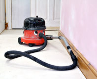 Happy working hoover vacuum cleaner. Photo of a happy hard working vacuum cleaner on a renovation project Royalty Free Stock Image