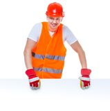 Happy working man in a helmet Stock Image
