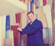 Happy workman standing with plywood pieces Stock Image