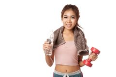 Happy Workout Asian girl with bottle of water and Dumbbell Stock Photo