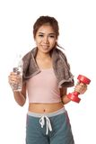 Happy Workout Asian girl with bottle of water and Dumbbell Royalty Free Stock Photography