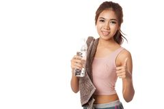Happy Workout Asian girl show thumbs up with bottle of water Royalty Free Stock Images