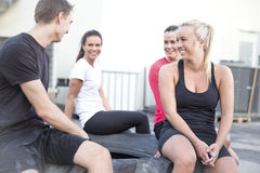 Happy workout team taking a break outdoor Royalty Free Stock Images