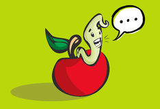 Happy worm coming out of a hole in an apple Royalty Free Stock Photography