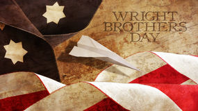 Happy Wright Brothers Day. America Flag Waves and Wood. Stock Images