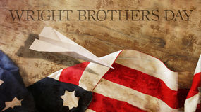 Happy Wright Brothers Day. America Flag and Wood. Stock Photo