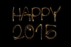 Happy 2015. Written with a sparkler isolated on black background Stock Images