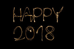 Happy 2018. Written with a sparkler isolated on black background Stock Photo