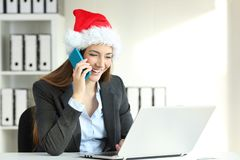Businesswoman working in christmas time. Happy wusinesswoman working and calling on phone in christmas time stock photography