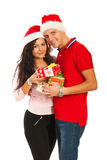 Happy Xmas couple holding presents Royalty Free Stock Photos