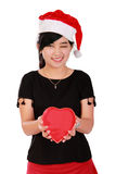 Happy Xmas girl holding heart shaped box Stock Photos
