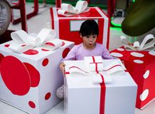 Wow. Surprised girl keeping mouth opened while staring at presents. Happy Xmas and New Year holiday! Shocked and surprised kid. Cheerful smiling little girl stock photography