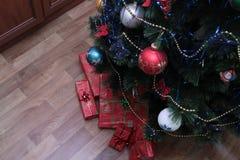Happy cute Xmas tree decorating Stock Photography
