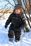 Happy 2 year toddler with rosy cheeks in winter Royalty Free Stock Images