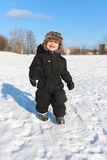 Happy 2 year toddler walking in winter Royalty Free Stock Photography