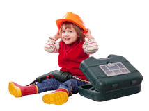 Happy child in hardhat with tools Royalty Free Stock Photos
