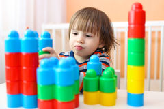 Happy 2 years toddler playing plastic blocks Royalty Free Stock Photos